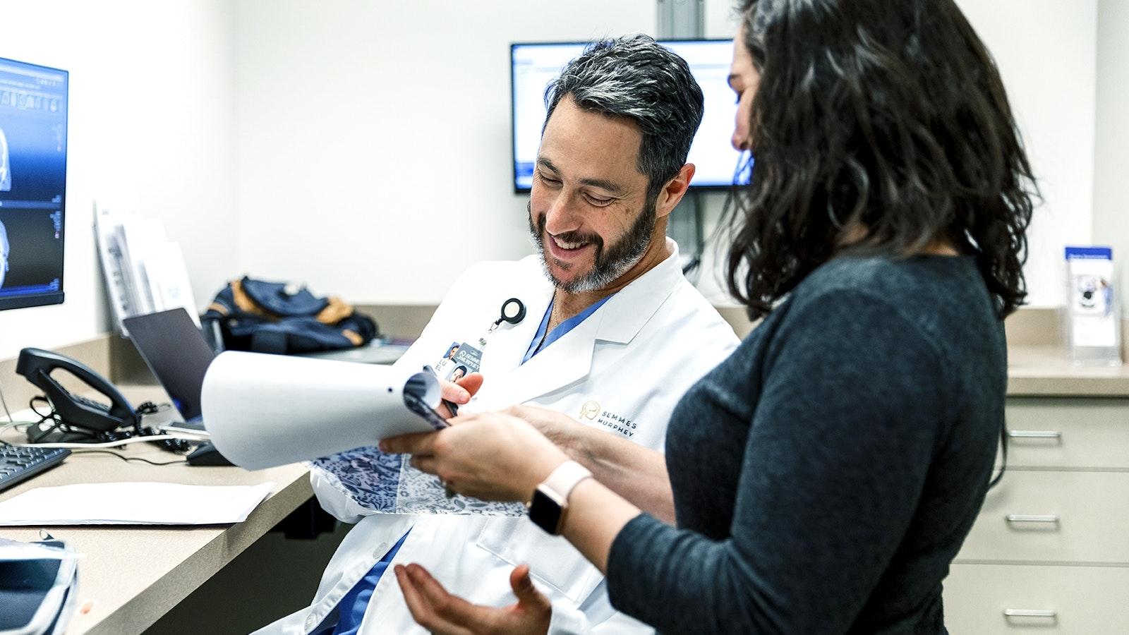 Doctor Elijovich looks over paper with nurse 0021