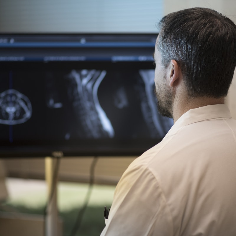 Doctor looks over x ray images