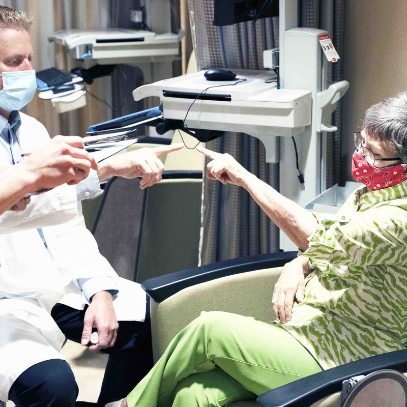 Dr. Bond at Semmes Murphey works with an essential tremor patient in Memphis
