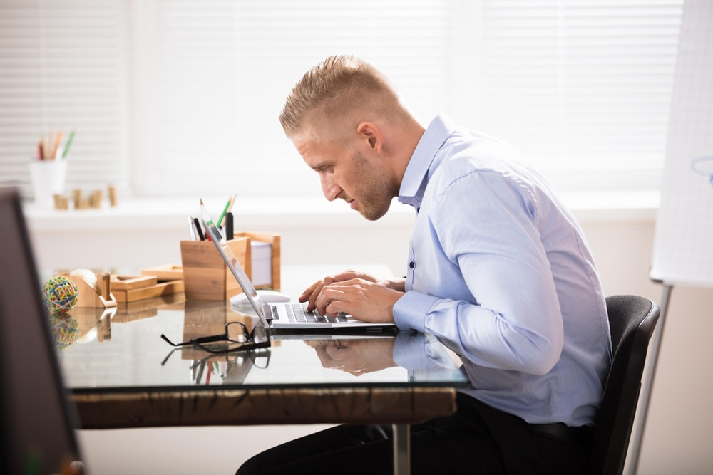 Man slouching at desk small